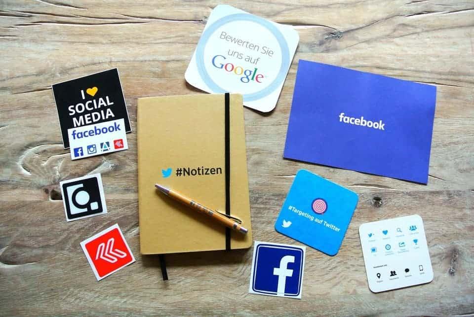 social media symbols around notebook