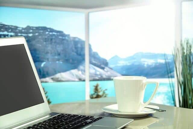 laptop and coffee in apartment with view