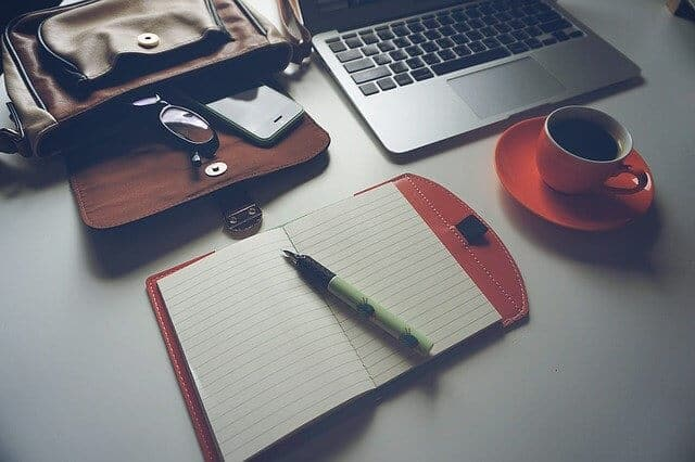 make money with blogging, notebook on table