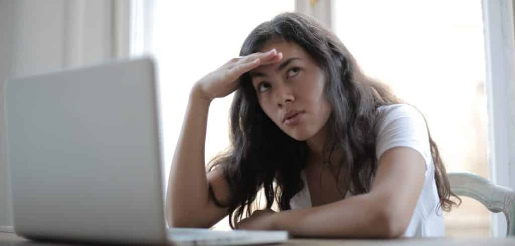 frustrated female in front of laptop