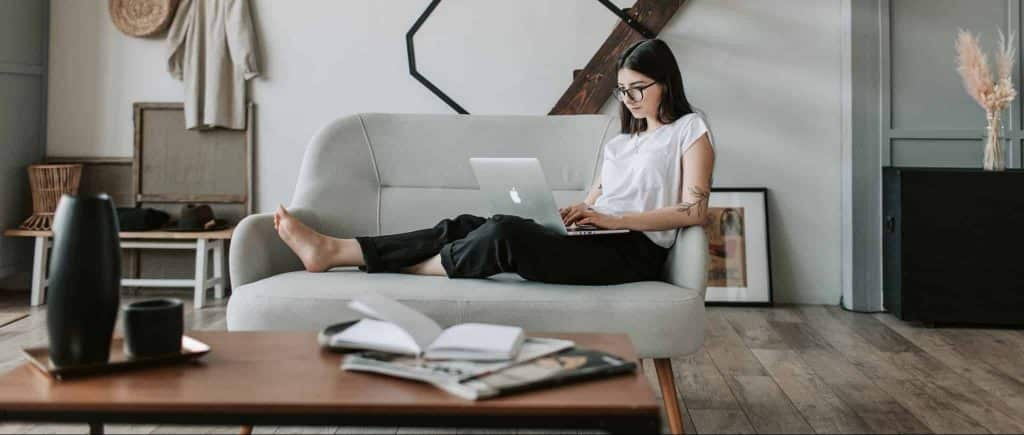 female affialite marketer with laptop on sofa